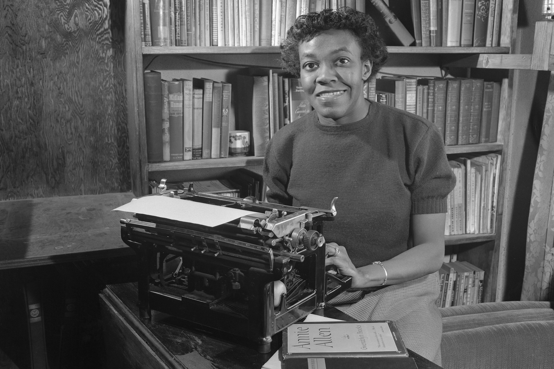 Black and white photography of poet Gwendolyn Brooks at her typewriter.