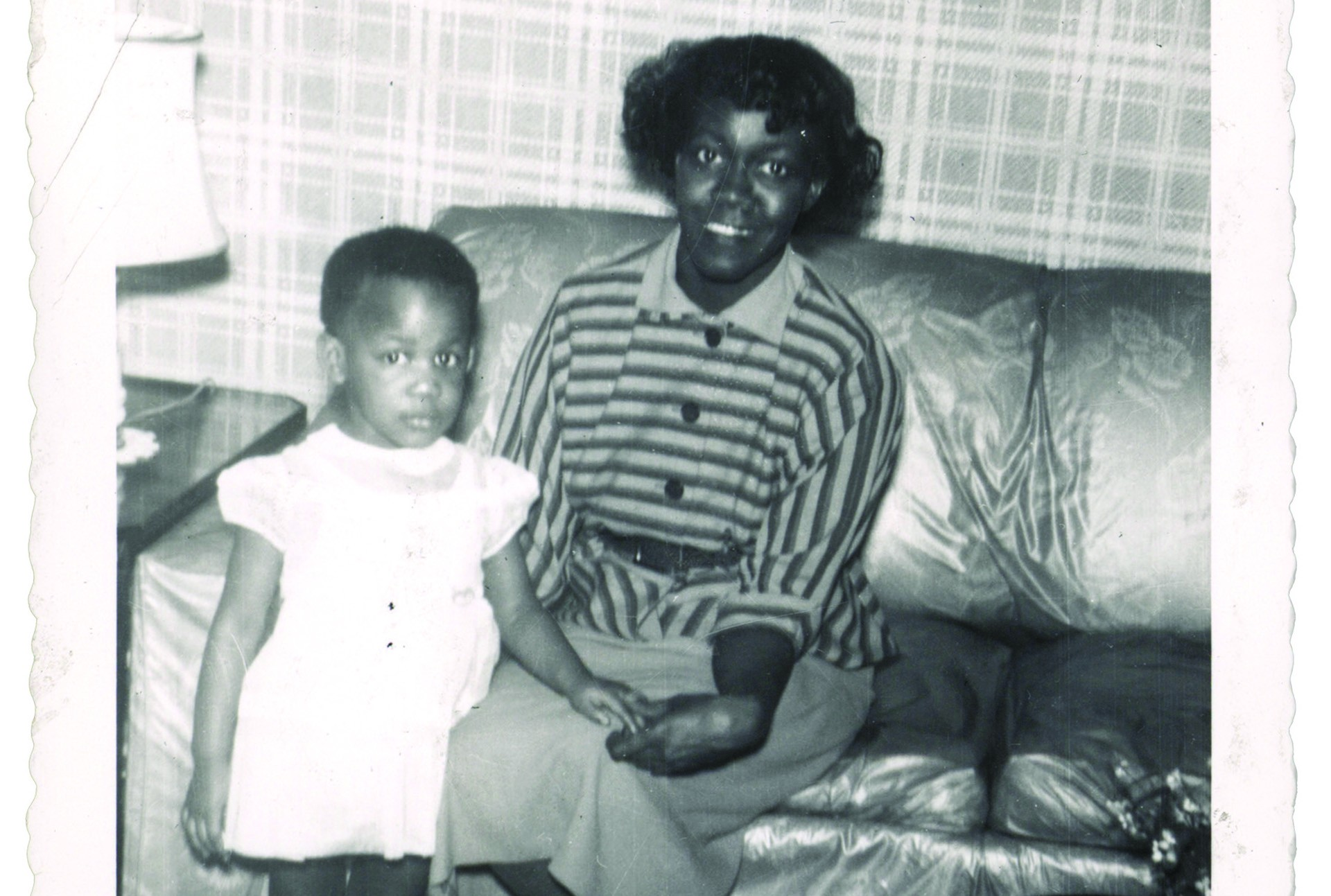 Black and white photograph of the poet Gwendolyn Brooks sitting on the couch with her daughter, Nora Blakely.