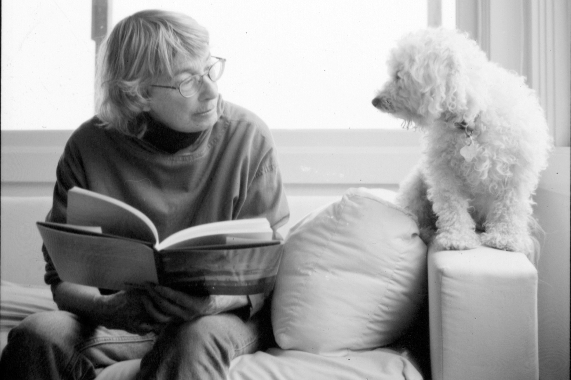 Image of Mary Oliver with her dog.