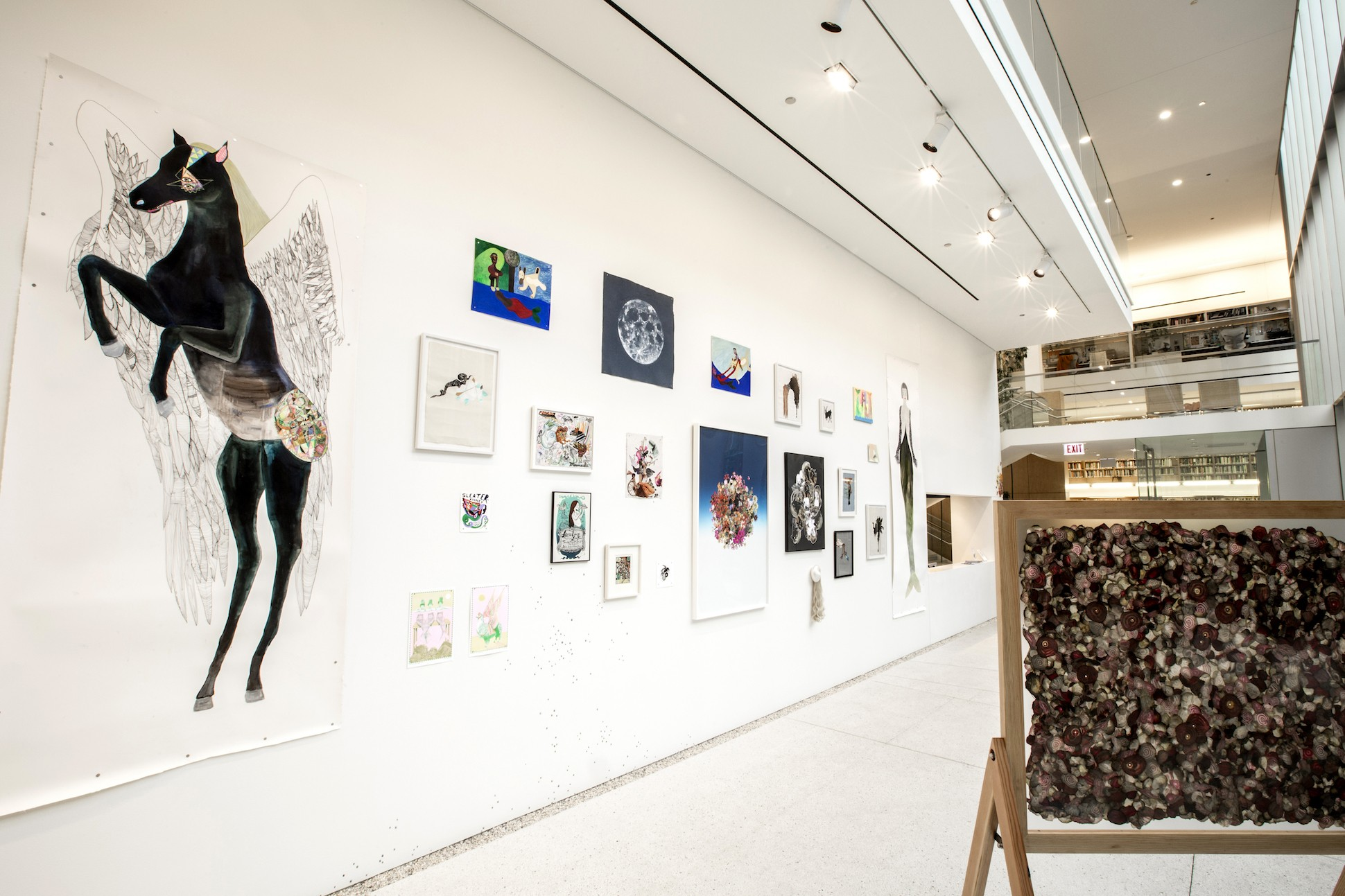 Gallery space of Pegasus and Mermaids installation, featuring large portraits of winged horses and mermaids.