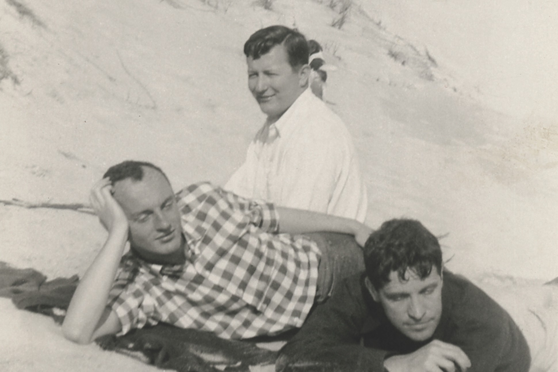 Black and white photo of Frank O'Hara, Hal Fondren, and Fairfield Porter on the beach in 1954.