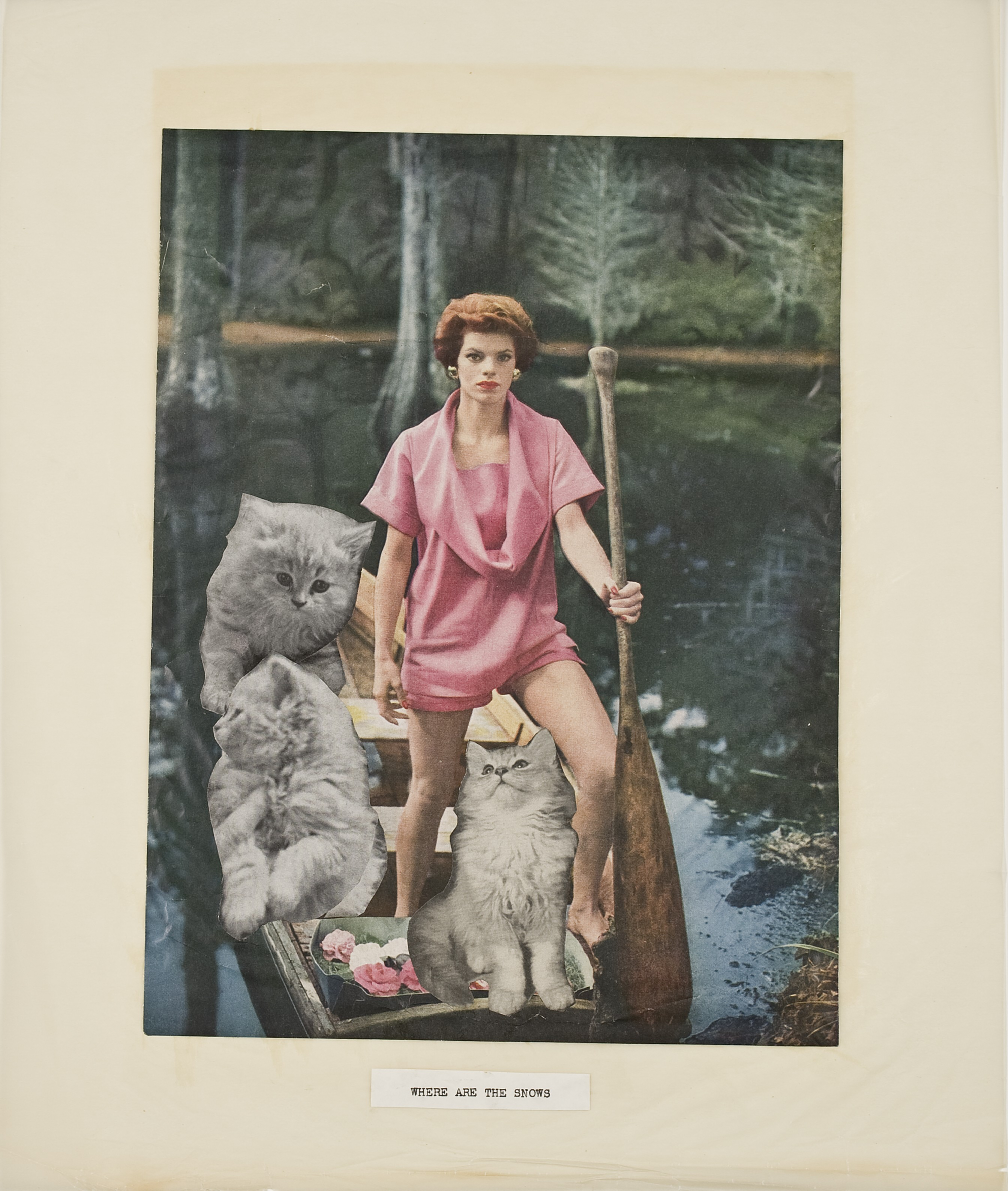 "A woman in a pink romper stands at the front of a canoe holding a paddle as if it were a scepter, with a view of a wooded lake behind her. Pasted into the canoe are three gray cats. At the bottom, the words ""WHERE ARE THE SNOWS."""