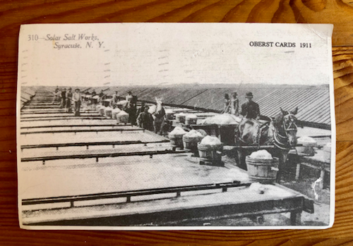 Old postcard showing salt workers drying salt water from Onondaga Lake.