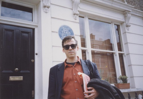 David Trinidad in front of Sylvia Plath's apartment