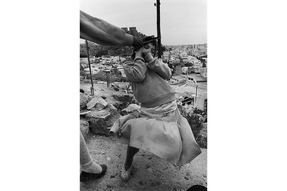 Photo of child dancing. Graciela Iturbide, Gitana, Almería, Spain, 1992