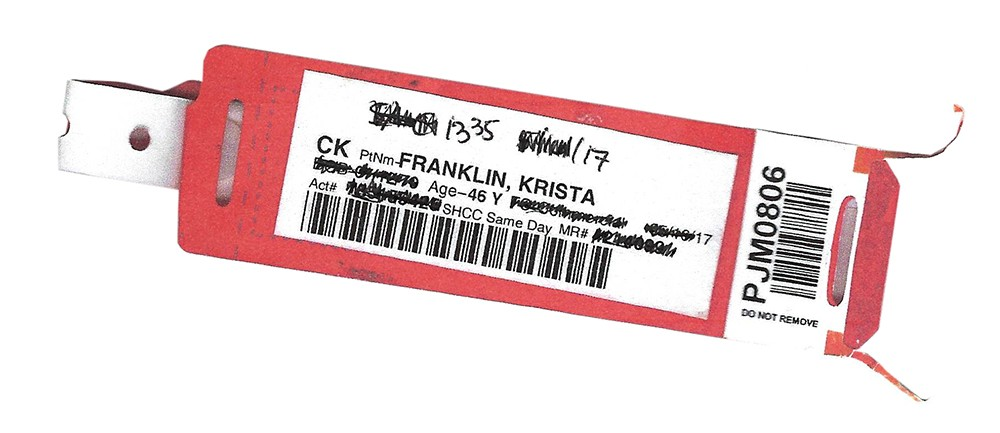 """Scan of a hospital wristband for patient """"Franklin, Krista"""" with redacted personal information."""