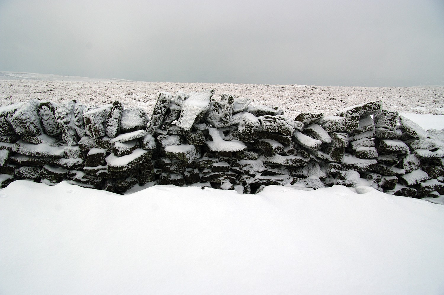 A barricade in a field covered in ice.