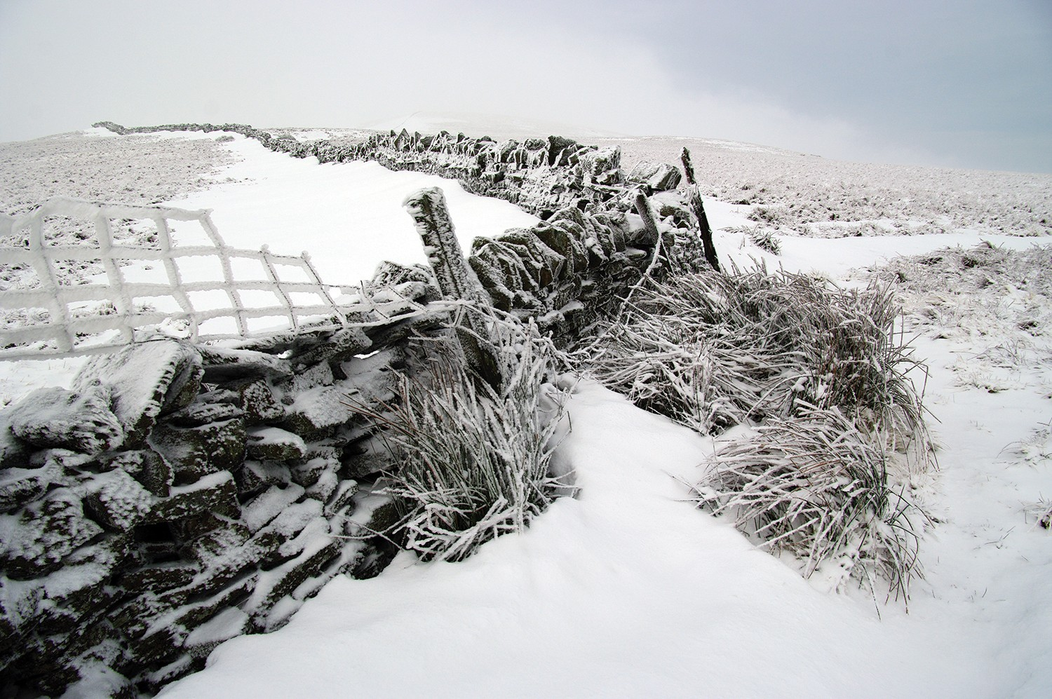 A barricade in a field covered in snow and ice.
