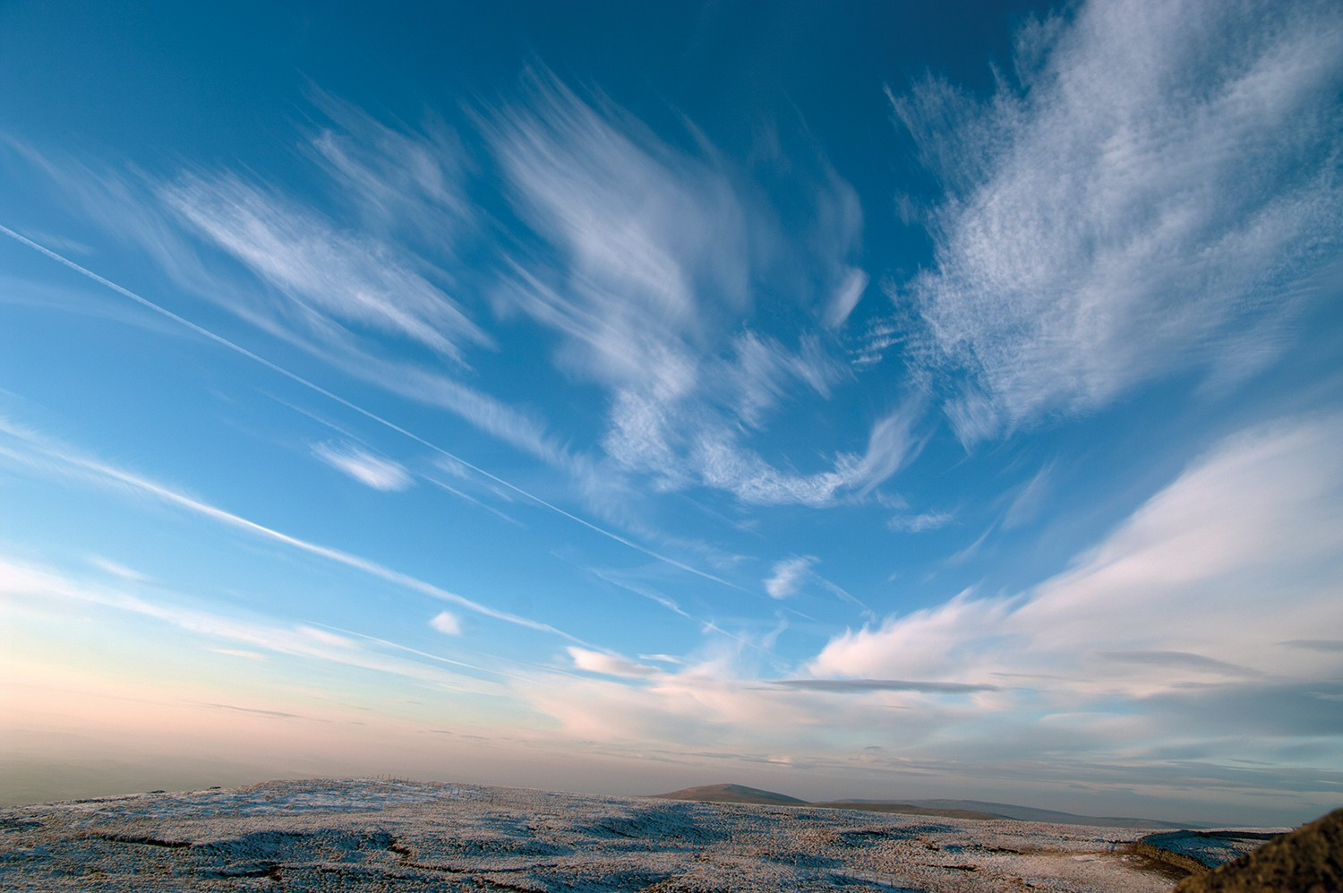 A landscape photo with wispy clouds.