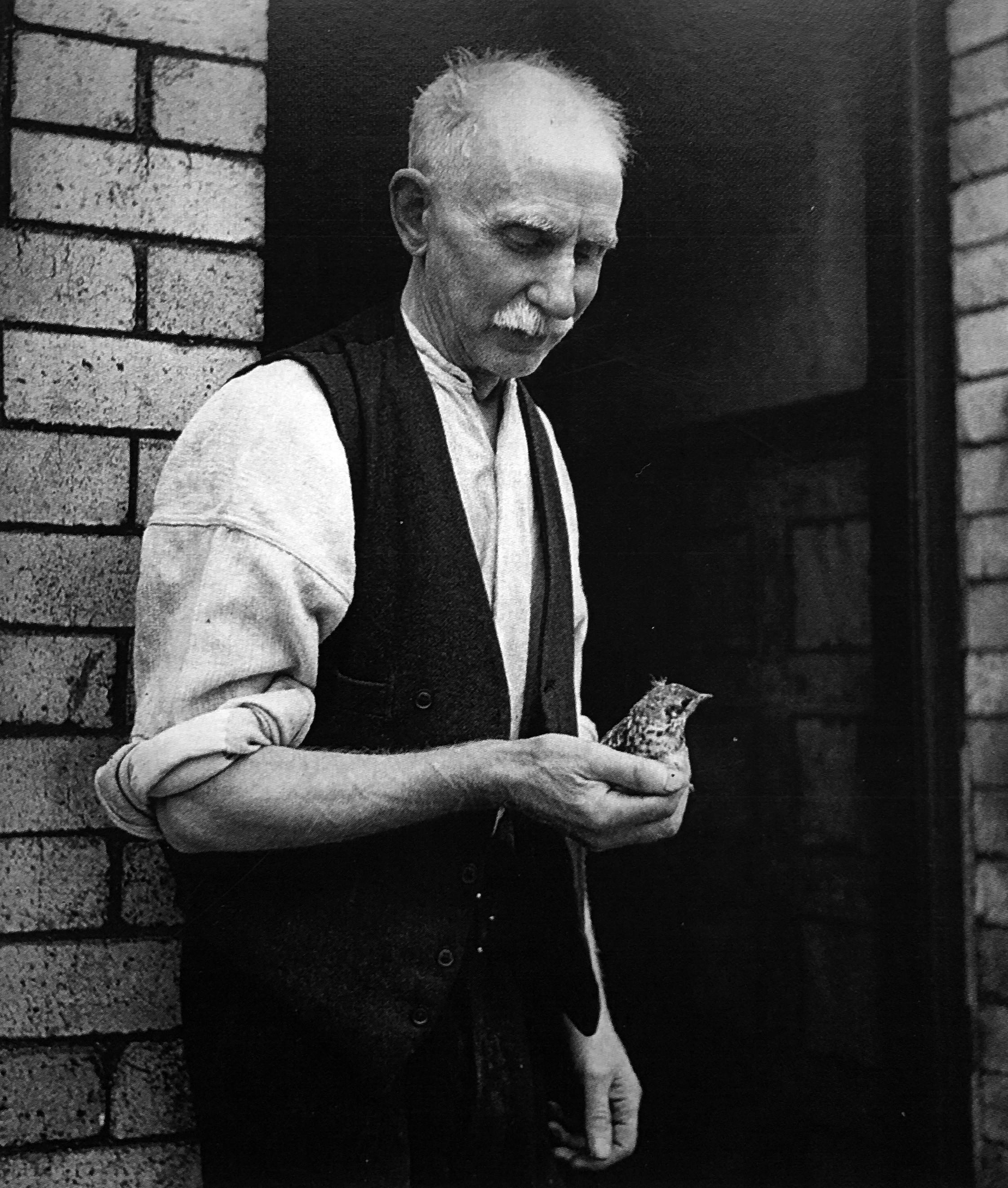 Edith Tudor Hart, <em>Man with Bird, Tyneside</em>, c. 1937, courtesy of Peter Suschitzky